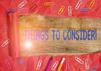 Handwriting text writing Things To Consider. Concept meaning think about something carefully in order to make decision Stationary and torn cardboard placed above a wooden classic table backdrop.